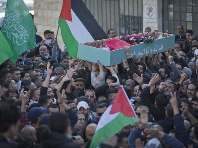Palestinian mourners carry the body of Bassel Ibrahim, who was shot dead by Israeli soldiers at the outskirts of his village during clashes following protests. Picture: AP