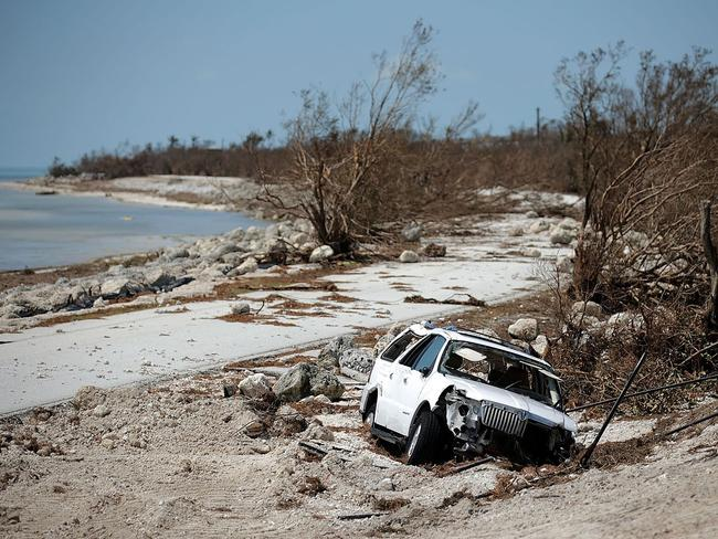 A storm-damaged truck is stuck in sand close to where Hurricane Irma washed out the two northbound lanes of Highway 1 in Bahia Honda, Florida. Picture: Chip Somodevilla/Getty Images/AFP