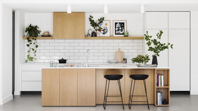A great reno with a butler's pantry (the door on the left) keeps appliances like toasters and kettles out of sight. Picture: Martina Gemmola