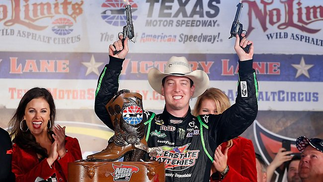 OBLIVIOUS to the tragedy: Winning driver Kyle Busch celebrates by shooting revolvers in Victory Lane after winning the NASCAR Sprint Cup race in Fort Worth, Texas, not aware that a fan had shot himself. Picture: Chris Graythen
