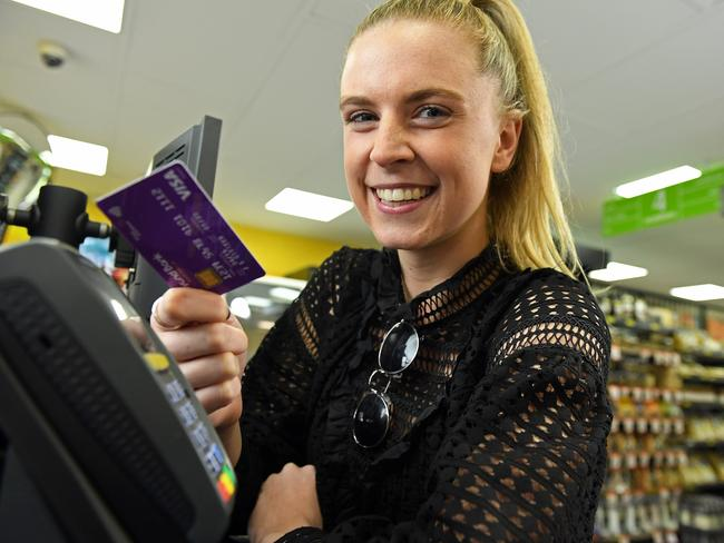 IN CONTROL: Lucy Thomas monitors her spending through an app on her phone. Photo Tom Huntley