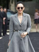 Acterss Zhang Ziyi poses upon arrival to attend the Christian Dior show as part of Paris Fashion Week - Haute Couture Fall/Winter 2014 in Paris, France. Picture: AFP