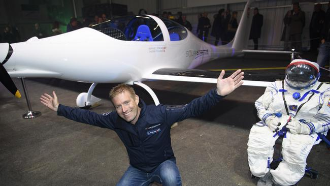 Swiss adventurer Raphael Domjan poses with the solar-powered plane SolarStratos during the roll out ceremony at the air base in Payerne, Switzerland. Picture: Laurent Gillieron