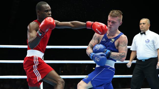 Daniel Lewis was ruled out of his quarter-final with a cut suffered in a win in this fight against Nigeria's Kehinde Ademuyiwa.