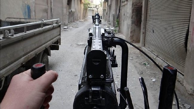 A rebel fighter aims his gun towards the frontline in Arbeen, on the outskirts of Damascus.