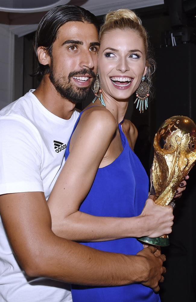 Sami Khedira celebrates his World Cup success with girlfriend Lena Gercke.