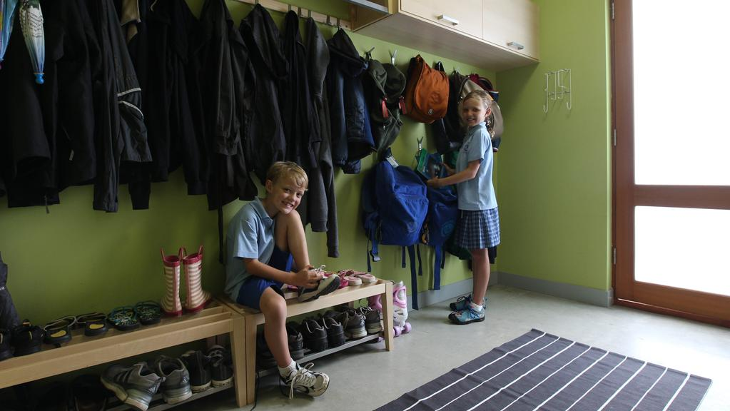 "Owen, 8, and Evelyn Brock settle into the ""drop zone"" room of their Wembley home. Picture: Ross Swanborough"