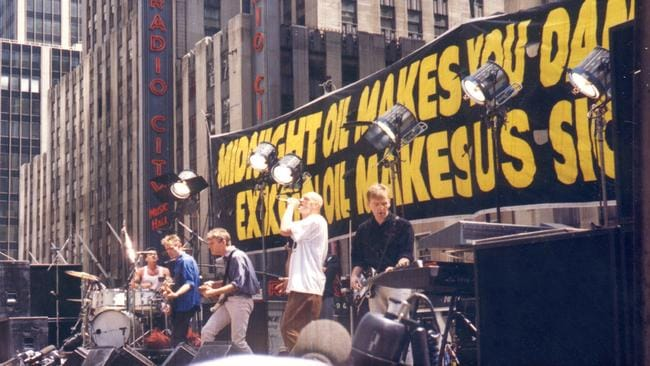 Midnight Oil stage their guerilla gig in front of the Exxon Oil building in New York in 1990.