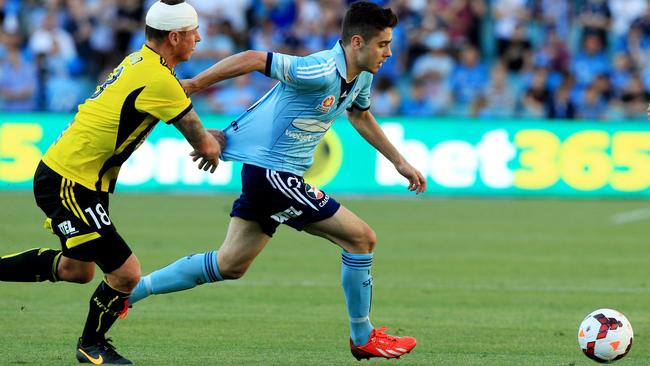 Chris Naumoff is chased down by Ben Sigmund during the A-League game between Sydney FC and Wellington Phoenix at Allianz Stadium last year. Picture: Mark Evans