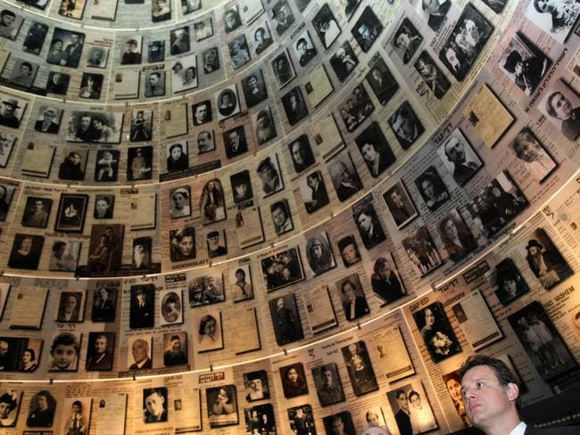 In memoriam ... a politician looks at pictures of Holocaust victims during a visit to the Yad Vashem Holocaust memorial in Jerusalem.