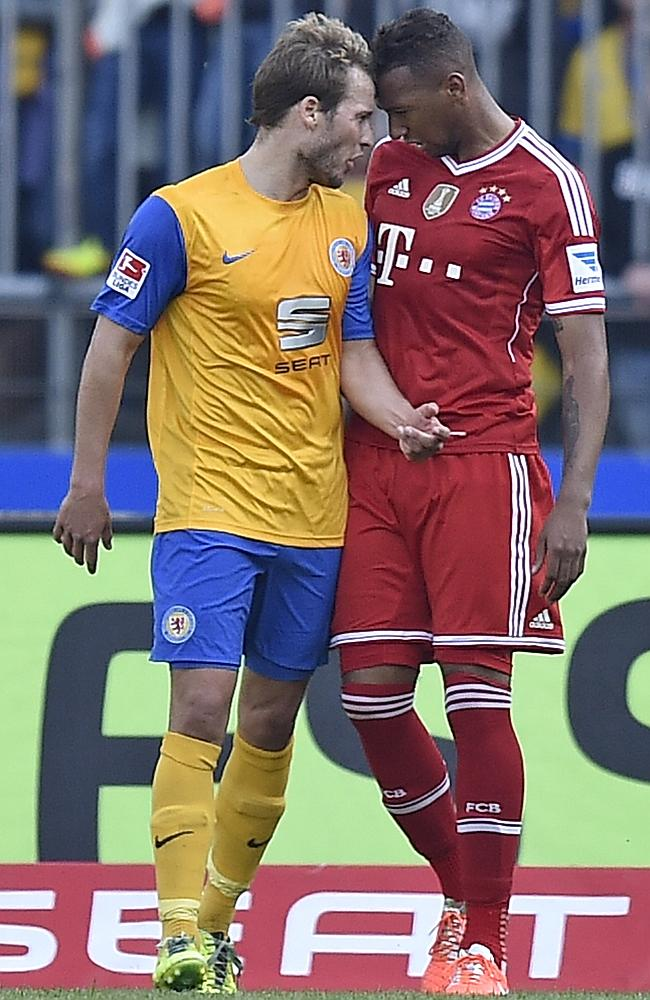 Braunschweig's Marco Caligiuri, left, and Bayern's Jerome Boateng get to know each other better.