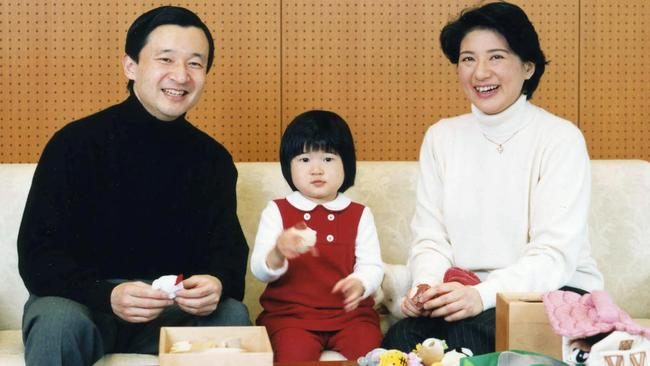 Japan's Crown Prince Naruhito and Crown Princess Masako with their daughter Princess Aiko at the Togu Palace in Tokyo, in 2004.
