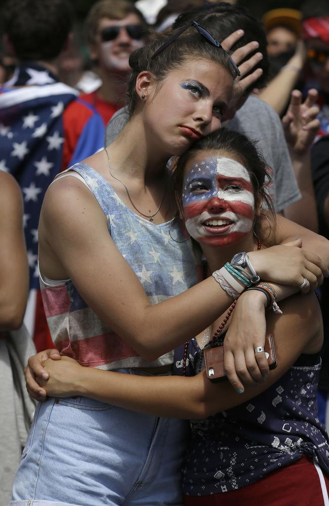 United States fans Anita Wray, left, hugs Sofia Trogu at a viewing party in San Francisco.