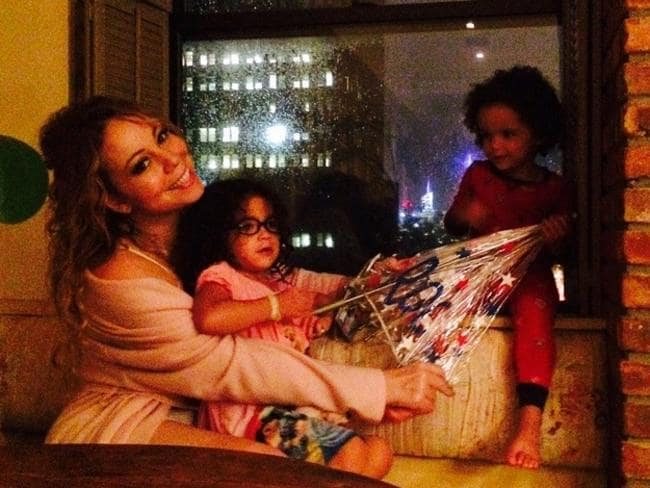 "Singer Mariah Carey shares an adorable family snap, ""Getting through the storm!"" Picture: Instagram"