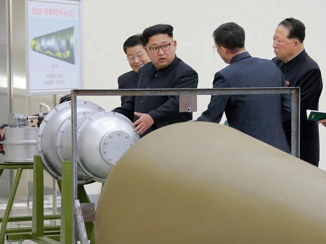 Kim Jong-un inspected the loading of a hydrogen bomb into a new intercontinental ballistic missile fairing, a claim to technological mastery that some experts doubt. Picture: AP