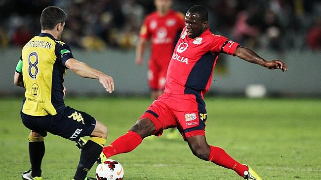 Adelaide United's Bruce Djite, right, in action during the elimination final against Central Coast Mariners. Picture: Liam Driver.