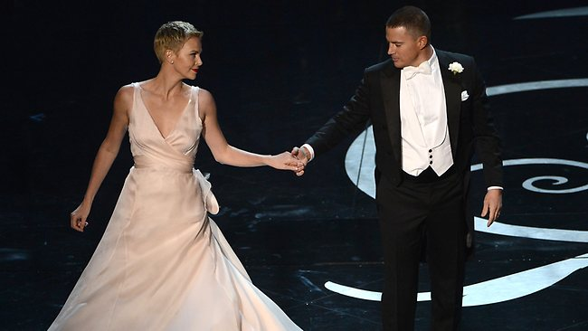 Actress Charlize Theron and actor Channing Tatum dance onstage during the Oscars. Picture: Getty