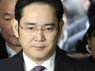 FILE - In this Jan. 18, 2017, file photo, Lee Jae-yong, front, a vice chairman of Samsung Electronics Co. arrives for the hearing at the Seoul Central District Court in Seoul, South Korea. South Korean prosecutors say they will indict Lee on bribery, embezzlement and other charges linked to a political scandal that has toppled President Park Geun-hye. (AP Photo/Lee Jin-man, File)