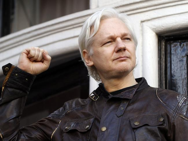 Julian Assange greets supporters outside the Ecuadorean embassy in London, Friday May 19, 2017. Picture: AP.