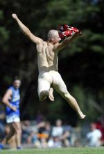 <p>A streaker leaps in the air as he runs across the ground at Morwell during the last quarter of the match between Hawthorn and Kangaroos at Morwell.</p>