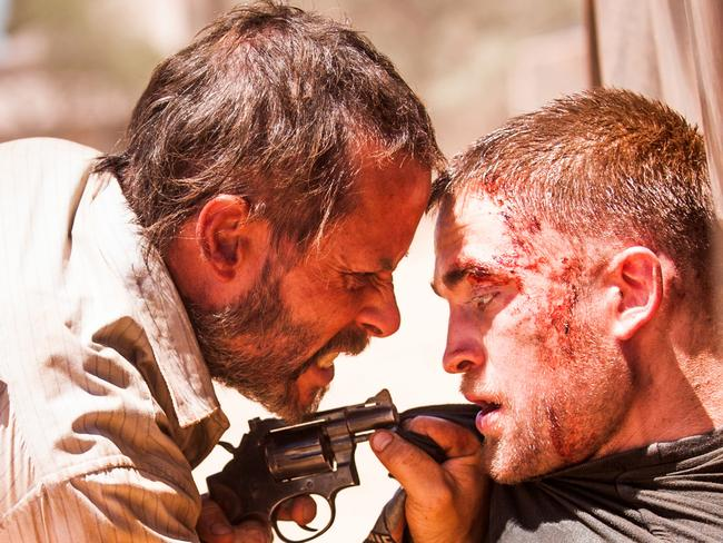 Guy Pearce and Robert Pattinson in a scene from  <i>The Rover</i>.