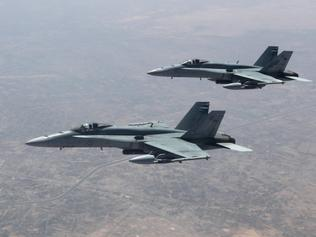 Strike Element F/A-18A's over the Taji Military complex on their transit home after a mission in northern Iraq. *** Local Caption *** At the request of the Iraqi Government, Task Group 630 (TG630), the Air Task Group of Operation OKRA, is operating within a US-led international coalition assembled to disrupt and degrade Daesh operations. TG 630 comprises six RAAF F/A-18 Hornets, an E-7A Wedgetail Airborne Early Warning and Control aircraft and a KC-30A Multi-Role Tanker Transport aircraft. There are nearly 350 personnel deployed, at any one time, to the Middle East Region as part of, or in direct support of the TG 630.