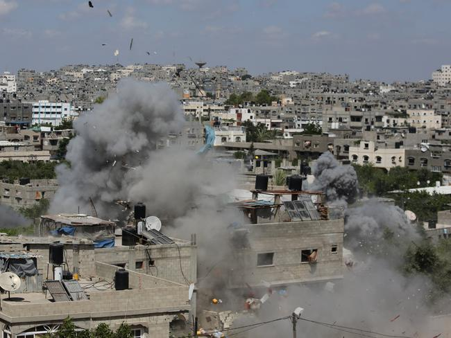Smoke and debris rises as an Israeli missile strike hits a building in Jabalya refugee camp in the northern Gaza strip yesterday. (AP Photo/Hatem Moussa)