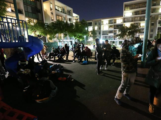 Pokemon Go players gather nightly at Peg Paterson Park at Rhodes. Picture: Richard Dobson