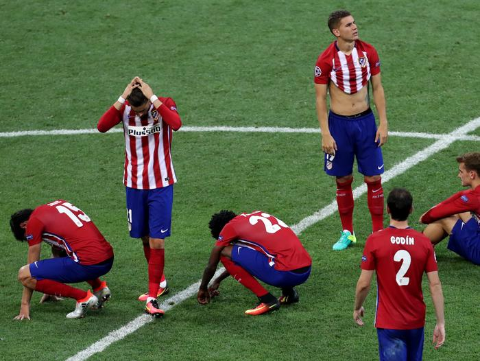 Atletico players reacts after Cristiano Ronaldo scored the winning penalty.