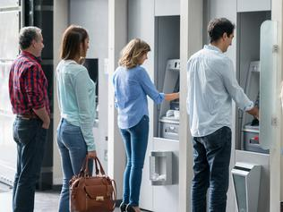 People in a line at an ATM