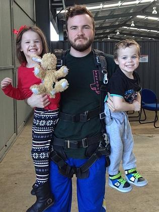 Brad Guy with his niece and nephew before his skydive.