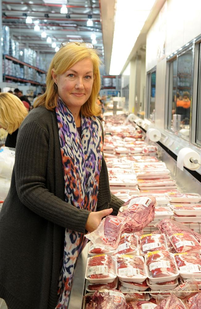 Customer Catherine Mellor with a large cut of meat at the Costco store in Auburn, western Sydney, NSW.