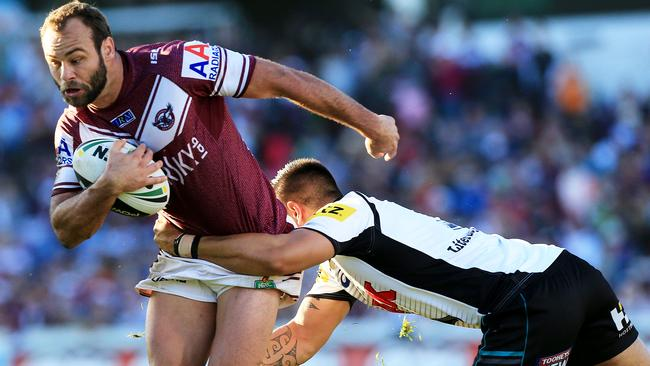 Brett Stewart tries to break through the Manly defence. Pic Mark Evans