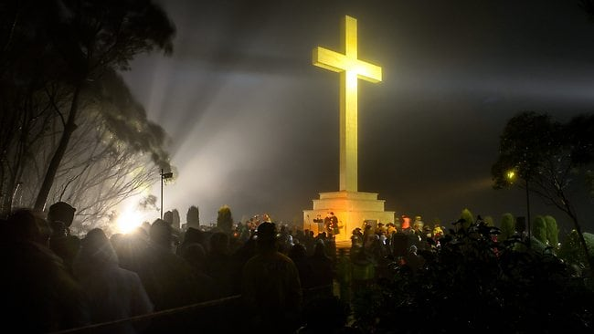 The dawn service at the cross on Mt Macedon in Victoria. Picture: Jay Town