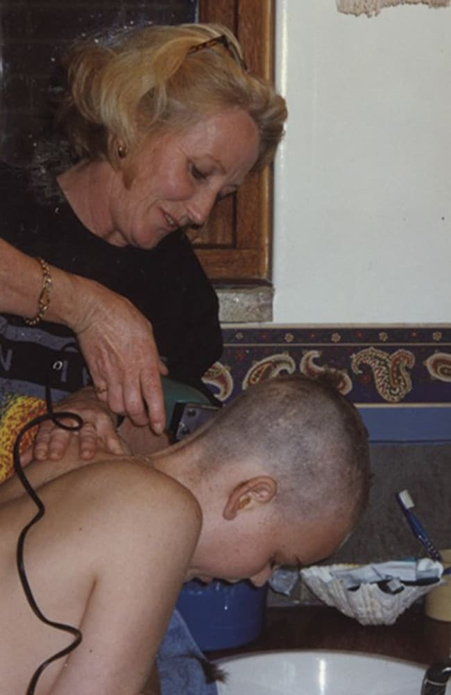 Luke, then 11, having his head shaved by his mum.