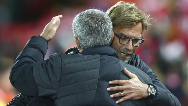 Liverpool's manager Jurgen Klopp, right, hugs Manchester United's manager Jose Mourinho.