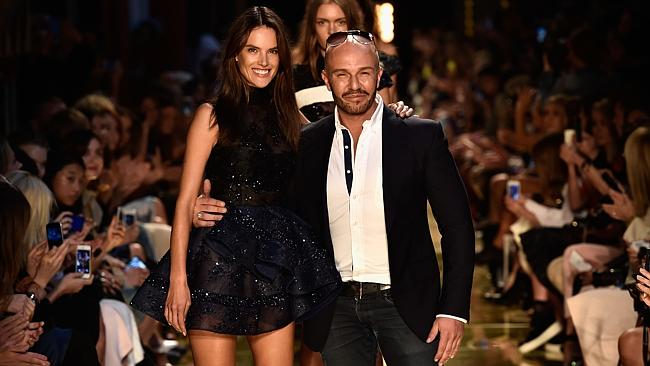 Perry poses with model Alessandra Ambrosio on the runway. Picture: Stefan Gosatti