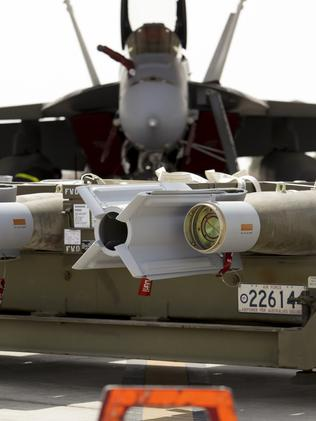 A RAAF Super Hornet awaits the weapons that will be loaded on to it.
