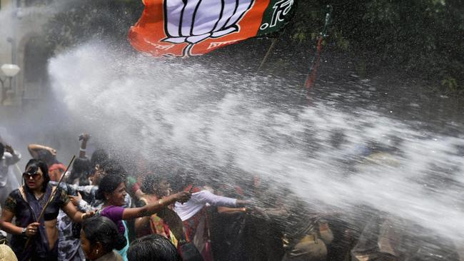 Can't even protest ... women activists face police water cannons as they demand action over the increasing number of attacks on women and girls.