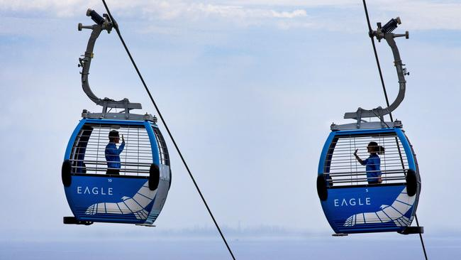 Arthurs Seat Eagle chairlift have invited schoolchildren and guests from around the Peninsula to be the first to ride the new chairlift. Carter Hodgson and Emily Metcalfe wave to each other as they pass by on their test ride with great views of Melbourne City buildings across the bay. Picture: David Caird