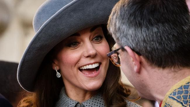 The Duchess of Cambridge flashes a grin as she leaves Westminster Abbey. Picture: AFP/Leon Neal