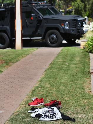 A bloodied shoe at the front of a home on Sheringa Cres, Salisbury Park. Picture: Tait Schmaal