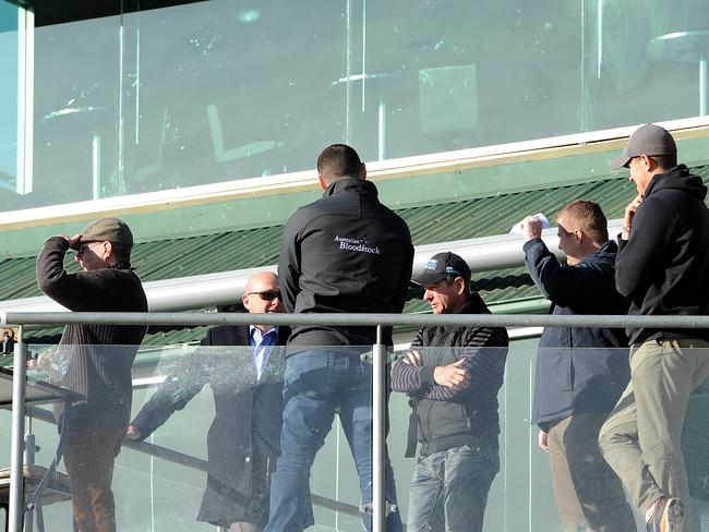 Trainer Kris Lees (middle with cap) and connections watch Lucia Valentina in the 900m barrier trial. Picture: Peter Lorimer