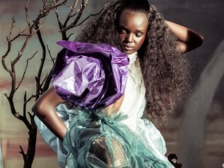 Duckie Thot as Alice from 'Alice in Wonderland'. Photo: Tim Walker/Pirelli