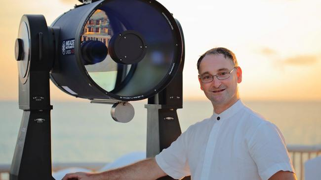 Mike Dalley with his telescope. It's his job to show the guests at these luxurious resorts the stars.