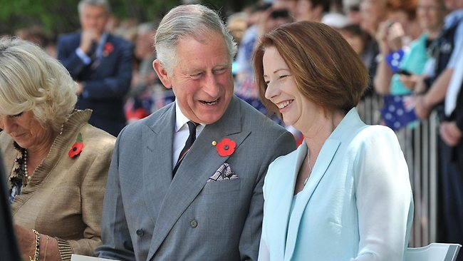 Prince Charles and Prime Minister Julia Gillard share a joke during the unveiling of a plaque at Queen Elizabeth Terrace in Canberra.