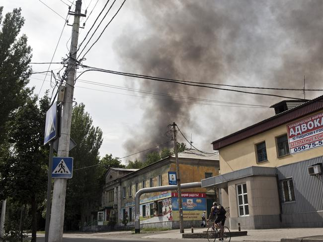 Signs of trouble ... Smoke coming from bombed factory ToshMash, 4 kilometres from the centre of Donetsk. Picture: Ella Pellegrini