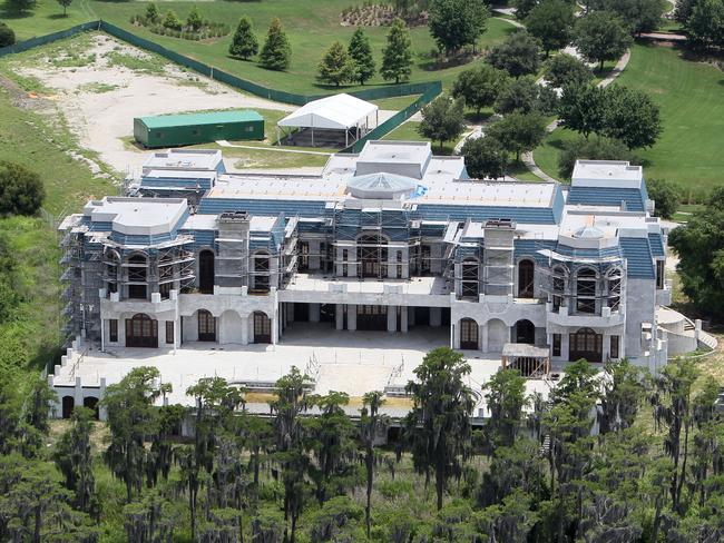 The unfinished Siegel mega-mansion was put ont he market before the family could move in.