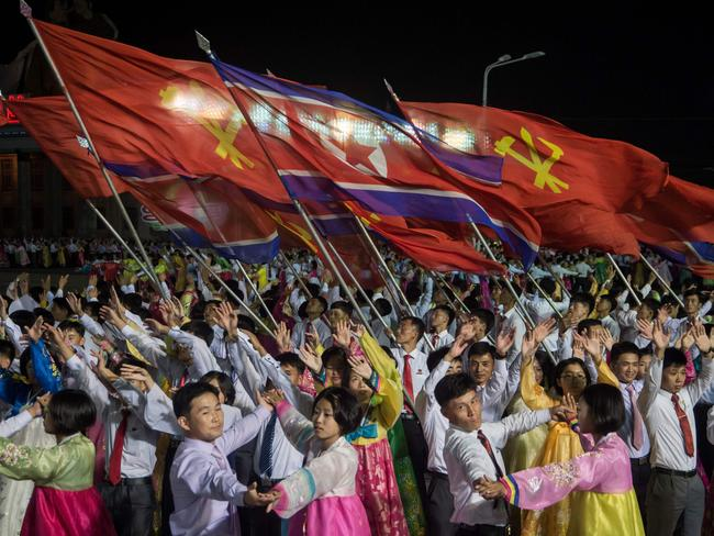In a photo taken on October 8, 2017 participants described as 'working people, youth, and students of Pyongyang' perform during a mass gala event marking the 20th anniversary of late North Korean leader Kim Jong Il's election as general secretary of the Workers' Party of Korea. Picture: AFP / KIM Won-Jin