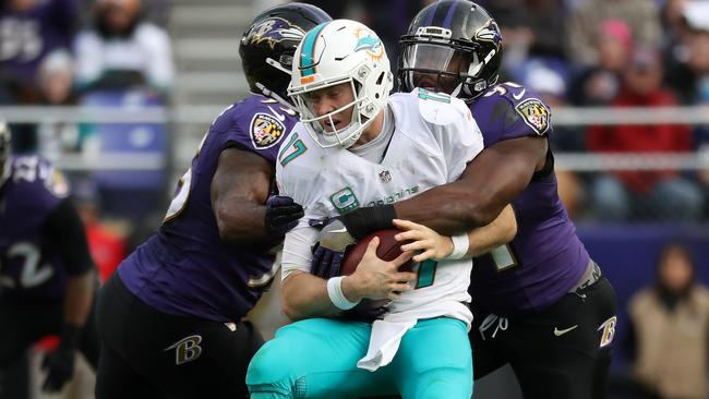 Quarterback Ryan Tannehill #17 of the Miami Dolphins is sacked.